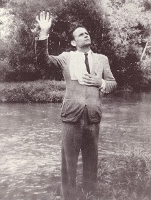 William Branham preaching by a creek.